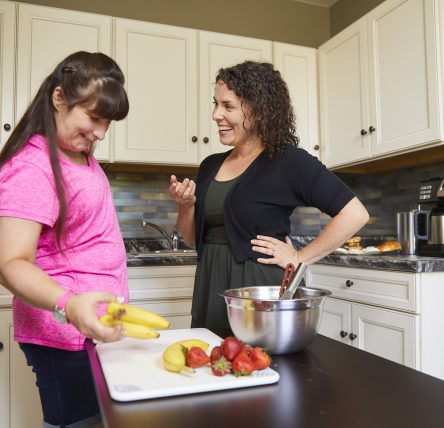 Female client and female staff member in kitchen