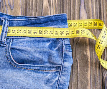 Jeans with measuring tape