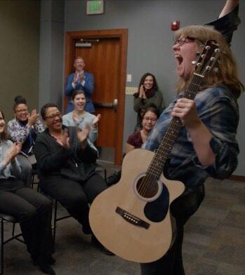 Megan playing guitar