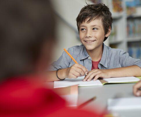 young boy doing school work