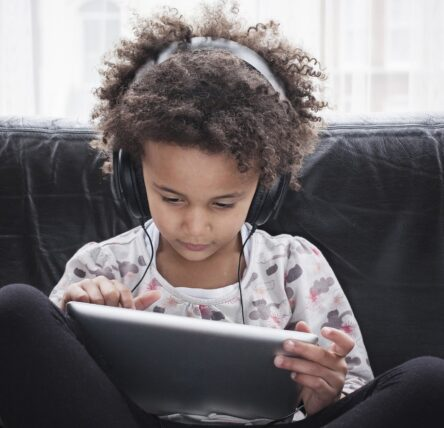 Girl using tablet with headphones